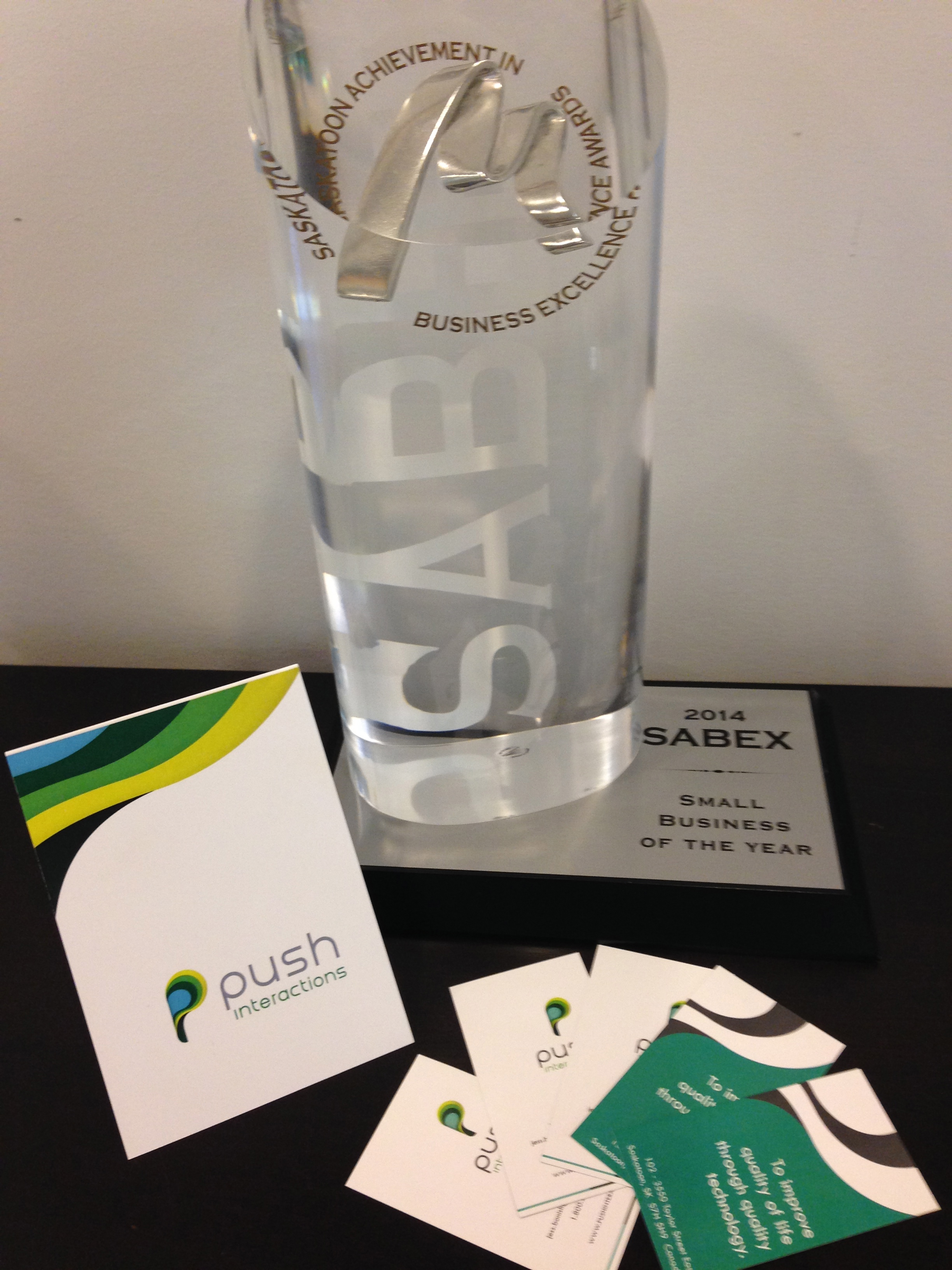 "New greeting cards and business cards beside the first award we ever won as ""Push"" (SABEX Small Business of the Year)"